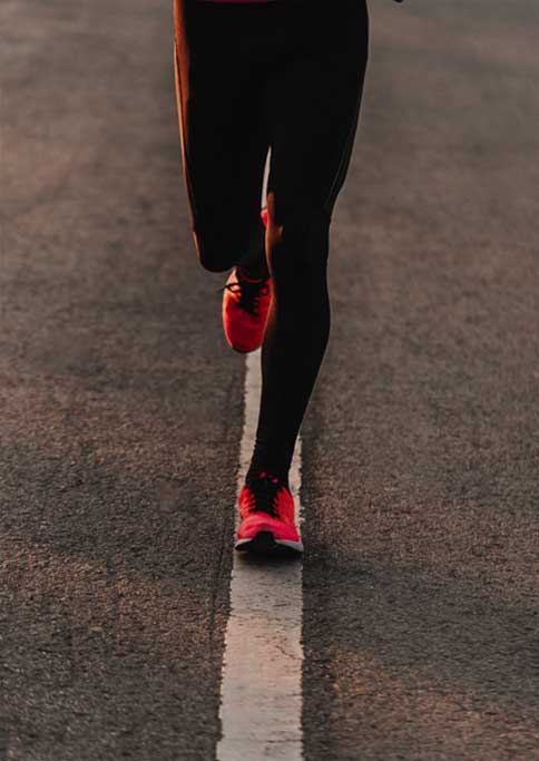 Close up of jogging in running shoes
