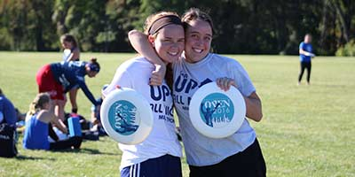Two Girls playing Ultimate Frisbee