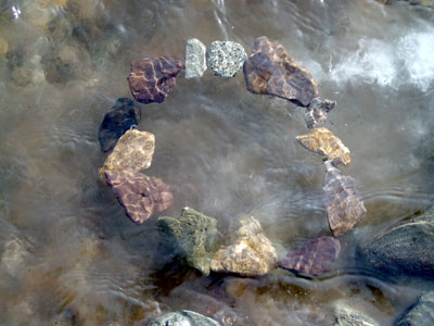 shimmering circle of stones under water