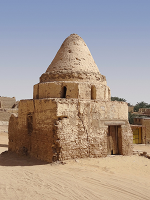 Stone house with cone shaped roof in desert