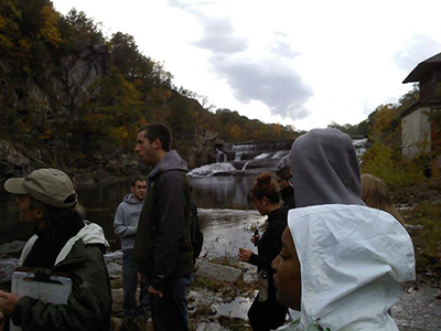 Geology and Astronomy students by a river