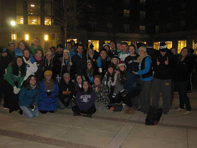 Honors Students group in front of building at night