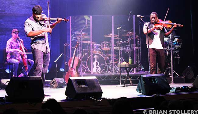 Black violin musicians performing on stage