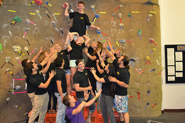 Campus Recreation Staff group in front of rock wall
