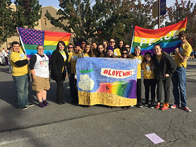 Students holding love wins banner