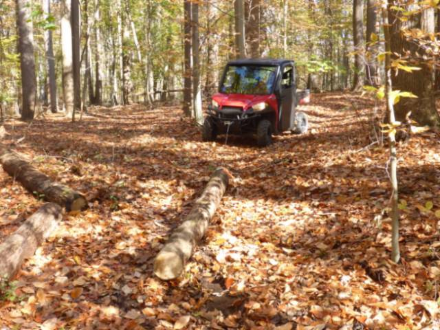 The The GNA's new Polaris UTV pulling a log into place
