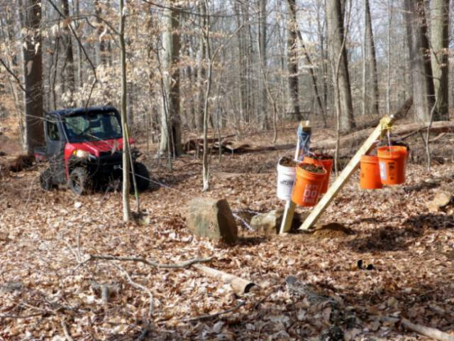 The GNA's UTV removing a boulder from a trail