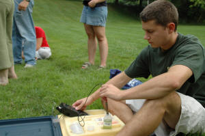 Student calibrates the pH meter for a stream measurement. Water Quality class, July 2007.
