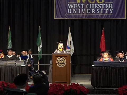 Graduating student speaking at a podium
