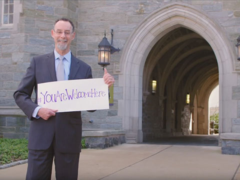 President Chris Holding #Youarewelcomehere sign