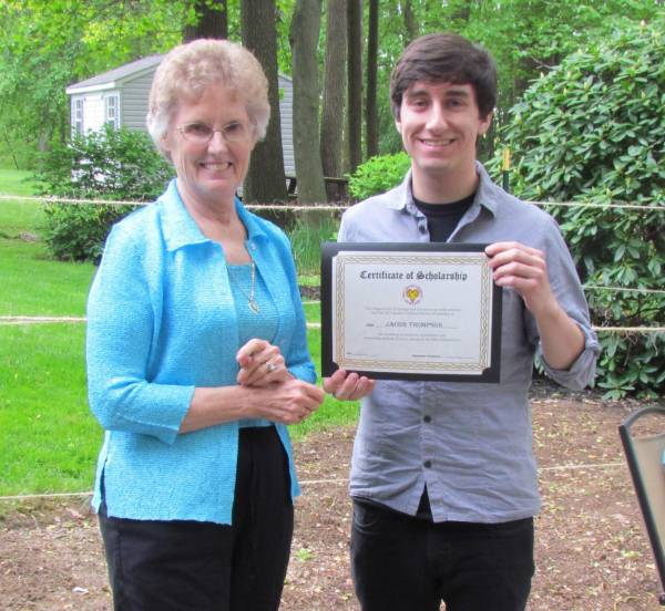 Student receiving a scholarship from donor Sandie Mather