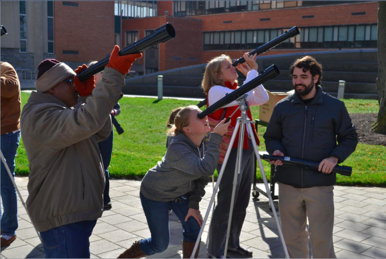 Students working with telescopes