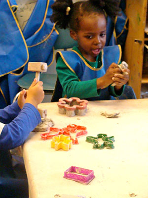 Children creating shapes with clay