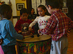Children learning to play the drums